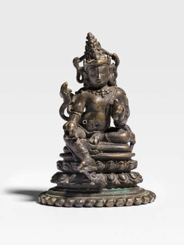 A COPPER ALLOY FIGURE OF KUBERA  NORTHEASTERN INDIA, PALA PERIOD, 12TH CENTURY