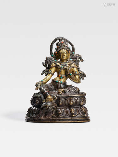 A SILVER AND COPPER INLAID COPPER ALLOY FIGURE OF SYAMATARA  TIBET, CIRCA 14TH CENTURY