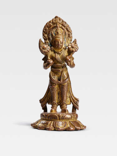 A GILT COPPER FIGURE OF SURYA  NEPAL, CIRCA 10TH CENTURY