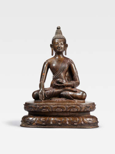 A COPPER ALLOY FIGURE OF BUDDHA   TIBET, CIRCA 13TH CENTURY
