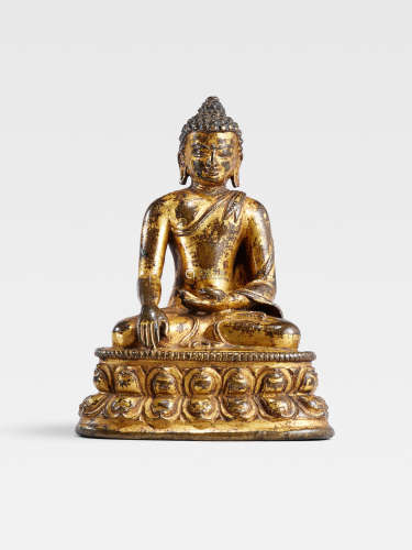 A GILT COPPER ALLOY FIGURE OF BUDDHA  TIBET, 14TH CENTURY