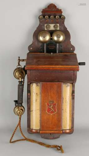 Antique Norwegian hanging telephone with wooden case.
