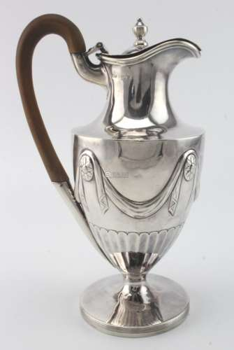 Adam style silver hot water jug with cancelled marks to the base and London Assay Office marks for
