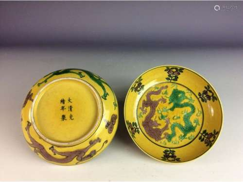 Pair of Chinese yellow glaze saucers, with twin