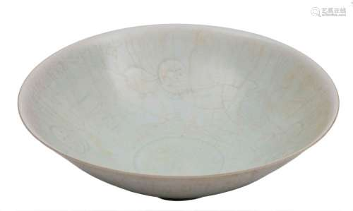 A Chinese Qingbai porcelain bowl: of circular form, covered in a crazed pale celadon glaze,