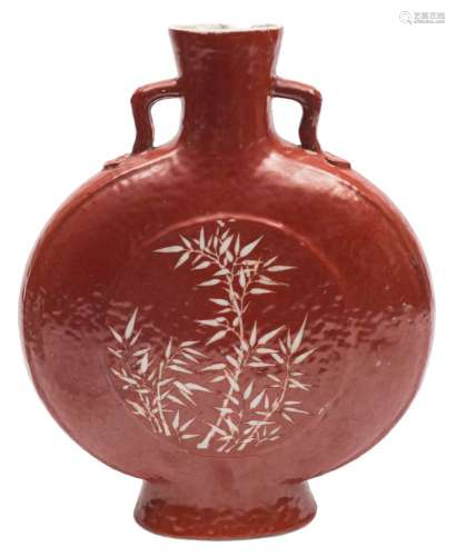 A Chinese coral ground moon flask: the short branch handles with ruyi-head terminals,