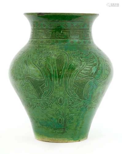 A green-glazed pottery vase,