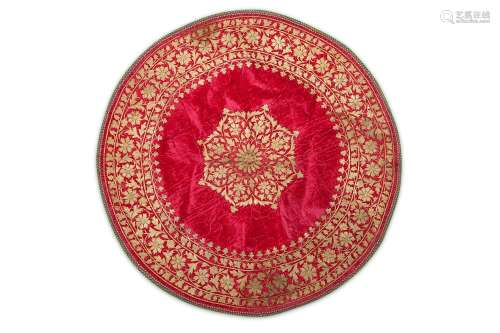 A CIRCULAR EMBROIDERED VELVET PANEL