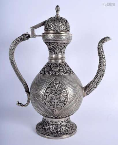 A LARGE INDIAN WHITE METAL KUFIC ISLAMIC COFFEE POT AND