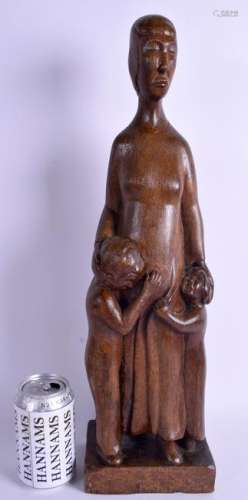 A STYLISH 1950S CARVED EUROPEAN WOOD FIGURE OF A FEMALE