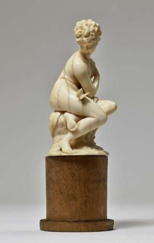 A Nymph with a ButterflyDieppe (?), late 19th Century Ivory, carved in full round. Mounted on