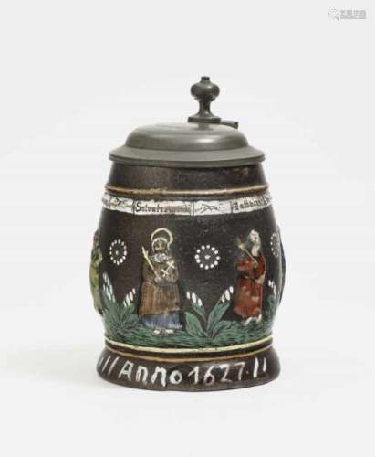 A TankardAnnaberg, dated 1627 Stoneware, decorated with colourful enamel paints. Pewter cover.