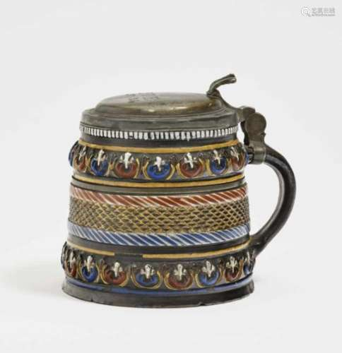 A TankardAnnaberg, circa 1680/1690 Stoneware with slip, decorated with colourful enamels and