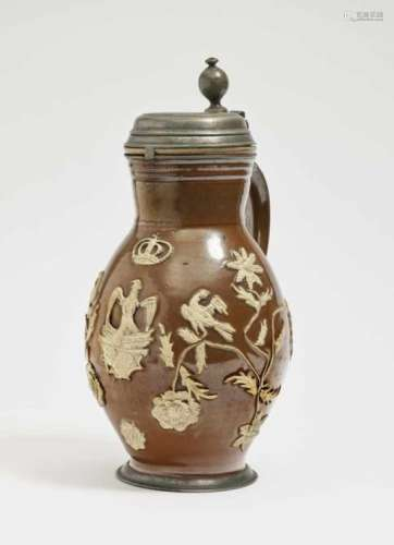 A Pear-Shaped JugBunzlau, 18th Century Stoneware with clay glaze and relief overlay. Pewter cover