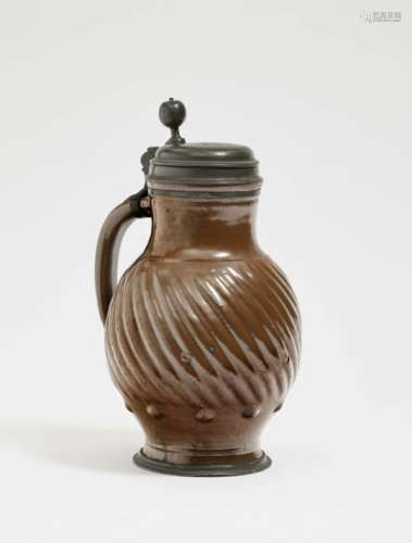 A JugBunzlau, 18th Century Stoneware with brown clay glaze. Pewter cover and base, monogrammed A.E.