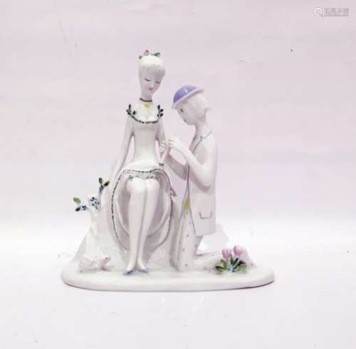 Rosenthal porcelain groupof a seated girl with kneeling suitor, 22cm high