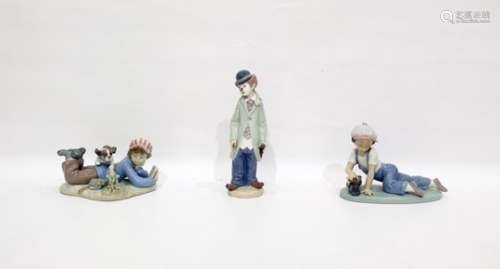 Lladro porcelain figureof a clown, Lladro porcelain figure of a lying boy with book and another