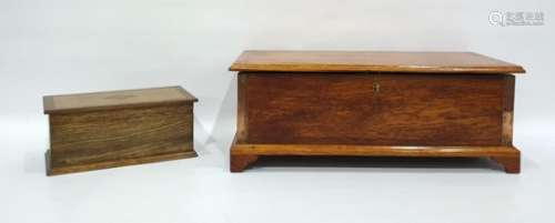 Oak box raised on bracket feet and an oak and inlaid tea caddy (2)