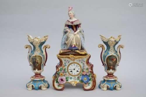 A three-piece porcelain clock set 'lady on a throne' (56cm)