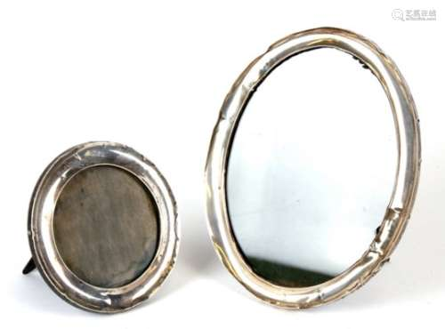 An oval silver strut photograph frame; together with a circular silver strut photograph frame (2).
