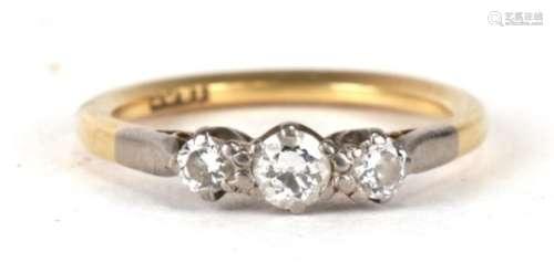 An 18ct gold three stone diamond ring, approx UK size 'L'.