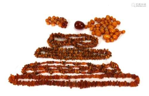 A quantity of amber and other beads and necklaces.Condition Report Weight of loose beads 154g.