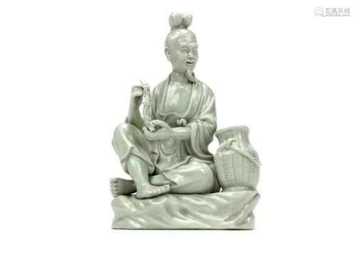 A 20TH CENTURY CHINESE BLANC DE CHINE FIGURE OF A MAN
