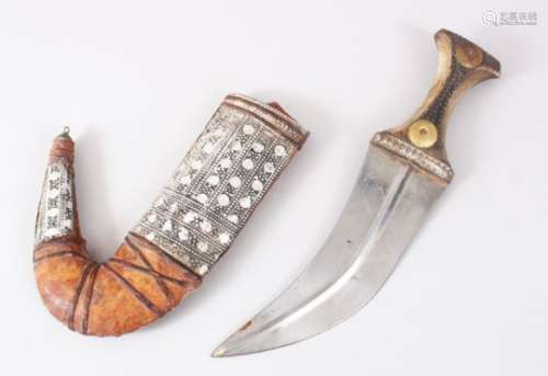 A GOOD PERSIAN JAMBYA DAGGER, with a wooden handle & white metal mounted sheath, 32cm long,