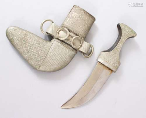 A GOOD PERSIAN JAMBYA DAGGER, the sheath with white metal and leather, 28.5cm long.