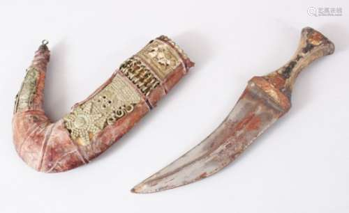 A GOOD PERSIAN JAMBYA DAGGER, the sheath formed from white metal and leather, the handle formed from