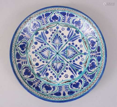 A 19TH CENTURY ASIAN BURKHARD BLUE AND WHITE CIRCULAR DISH, 32cm diameter.