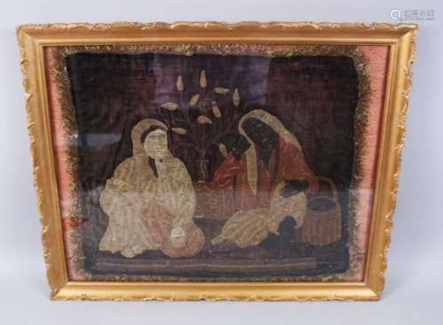A 19TH CENTURY OTTOMAN TURKISH EMBROIDED PICTURE OF TWO LADIES sitting with a vase of plants between
