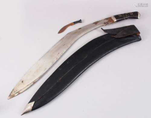 A LARGE NEPALESE KUKRI in a leather scabbard with small knife.
