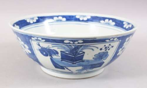 A GOOD 19TH CENTURY CHINESE BLUE & WHITE PORCELAIN PRUNUS BOWL, the exterior with panel decoration