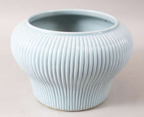A GOOD CHINESE ROBINS EGG GROUND RIBBED PORCELAIN JARDINERE, the body ribbed, the base unglazed,