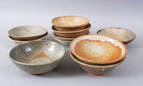 A MIXED LOT OF EARLY CHINESE POTTERY BOWLS, some glazed and some unglazed, various sizes but approx.