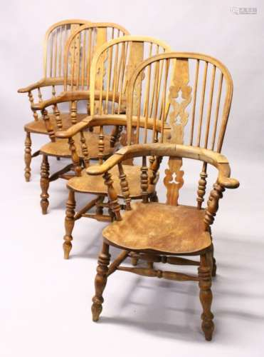 A GOOD SET OF FOUR 19TH CENTURY OAK WINDSOR HIGH BACK ARMCHAIRS.