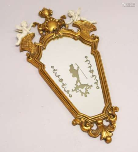 A FRENCH STYLE GILT FRAMED MIRROR, mounted with cherubs. 2ft 10ins high x 1ft 5ins wide.