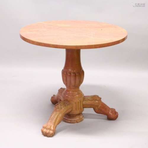 A CLASSICAL STYLE PINK VARIEGATED MARBLE CIRCULAR TRIPOD TABLE, with a carved baluster column, three