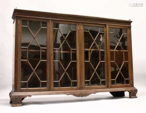 A GEORGE III DESIGN MAHOGANY LOW BOOKCASE, with dentil and blind fret cornice, four astragal