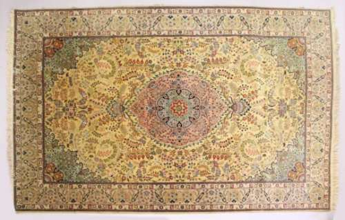 A GOOD PERSIAN CARPET, 20TH CENTURY, beige ground with central floral panel within a similar border.