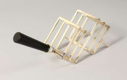 A CHRISTOPHER DRESSER STYLE TOAST RACK.