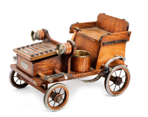 A large smoker's companion in the form of a Veteran motor car,