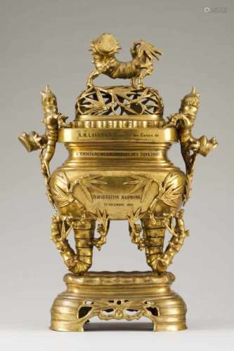 A large lided incense burner with standGilt bronzeMoulded and raised bamboo decorationInscribed