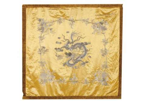 A textile panelSilkEmbroidered raised decoration with central five claw dragon in pursuit of the