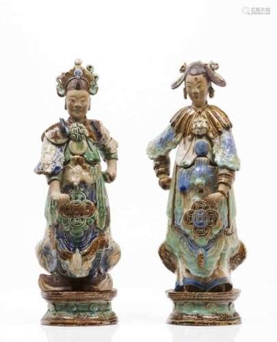 A pair of oriental figuresGlazed stoneware sculpturesPolychrome Sancai decoration(one restored,