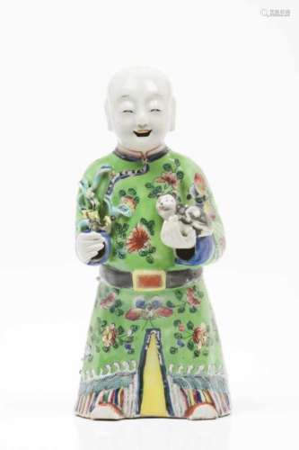 A laughing boyChinese porcelain sculpturesPolychrome decorationQing dynasty, 19th centuryHeight: