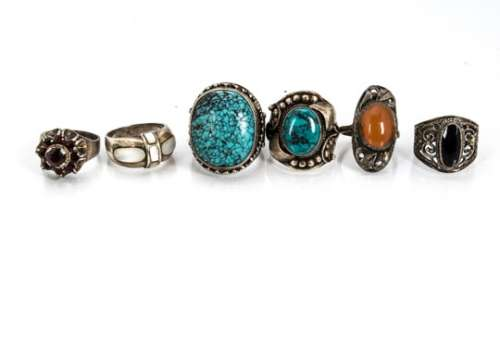 A collection of white metal gem set and plain Middle Eastern and contemporary silver dress rings