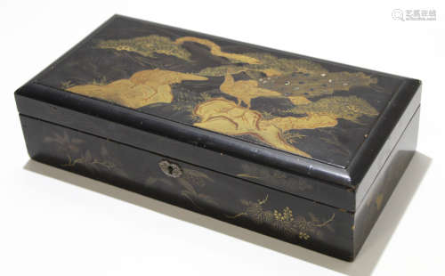 Oriental lacquer box with fitted interior, the cover decorated with peacocks, 35cm long