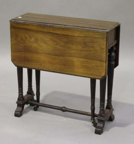 A late Victorian rosewood Sutherland occasional table, in the manner of Collinson & Lock, the canted